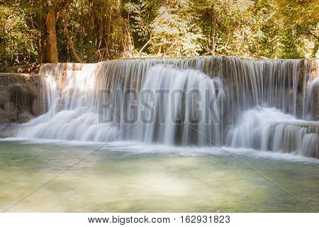 Natural deep forest waterfall, long exposure, natural landscape
