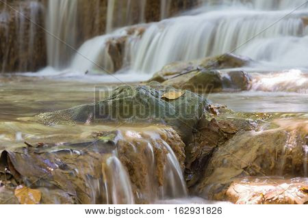 Close up stream waterfalls in natural deep forest, natural landscape background