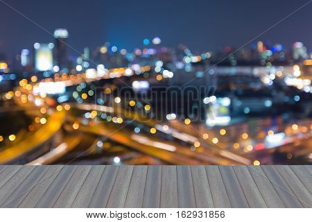 Opening wooden floor, Abstract blurred lights city downtown and highway at twilight