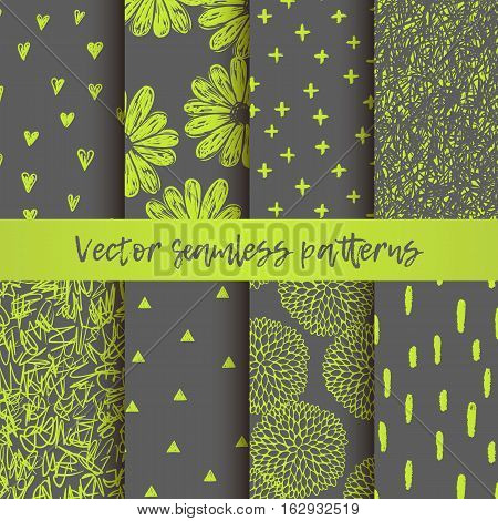 Vector set of seamless vector patterns with triangles, hearts, doodling round flowers, chaotic scribbles, brush stroke. Gray and lemon colors.