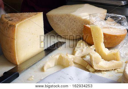 Food street market. Cut pieces of pecorino cheese.