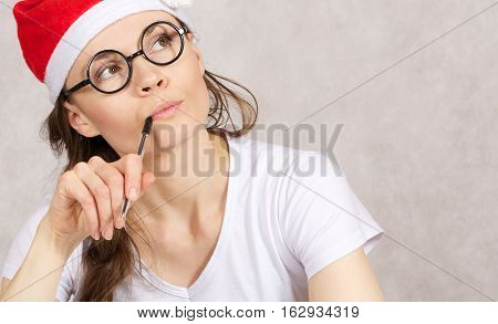 Young Blogger With A Pen In Her Mouth
