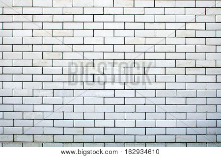 White brick wall background. Texture of a brick wall close-up.