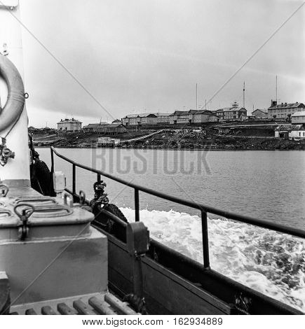 View of the island village of Dickson on Board a boat on a cloudy day. Photo of the late 1970-ies.