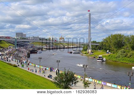 The embankment in Tyumen and the cable-stayed foot bridge. June 2016 Tyumen Russia