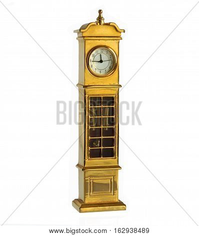Retro gilded miniature grandfather clock isolated on white background