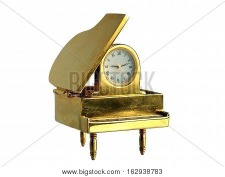 Retro gilded table clock Piano isolated on white background