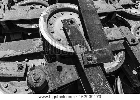 Abstract photograph of pulley wheels used in ski chairlifts with a weathered patina after being abandonded.