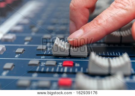 selective focus finger sound tuning of sound mixer. stock photo