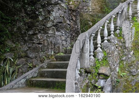 Old vintage staircase with steps and handrail made of concrete