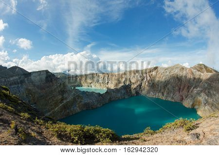 Colored crater lakes in caldera of Kelimutu Volcano, Flores, Indonesia