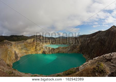 Caldera of Kelimutu volcano with colored lakes in crater, Flores, Indonesia