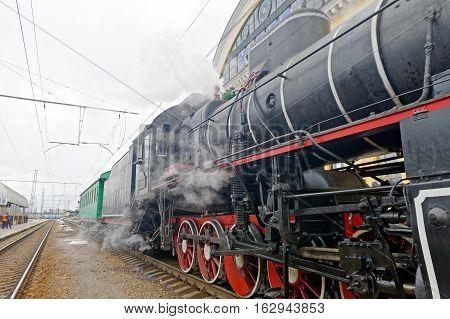 Restored steam locomotive Er-794-12 near the platform of railway station