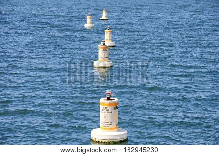 Environmental monitoring buoys in the waters of San Diego Harbor in California.