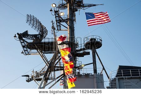 The mast and ships flags on the USS midway museum in San Diego California.
