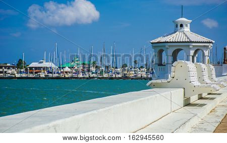 Corpus Christi Texas USA a Coastal Gulf of Mexico town along the southern gulf coast. the long sea wall and Gazebo with marina and T-head in the background on a nice sunny summer day
