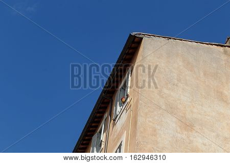Building Facade With Windows, On Blue Sky, Rome, Italy