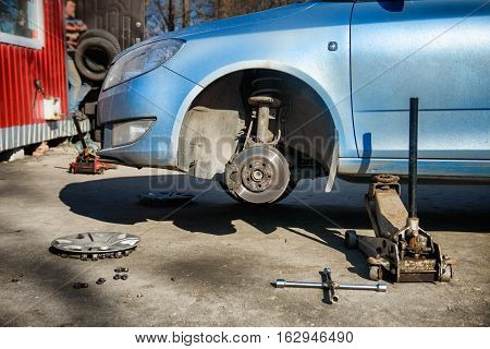 Replacement tires on the car at the service station