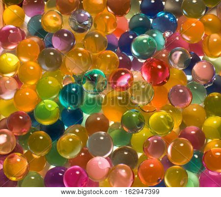 many colored hydrogel beads beautiful bright background