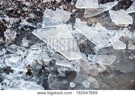 broken ice pieces on ground in winter