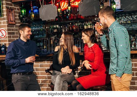 women laugh at the jokes at the bar, a fun evening in great company