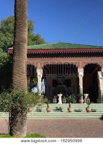 Traditional Moorish Architecture with palm tree in Marrakesh, Morocco