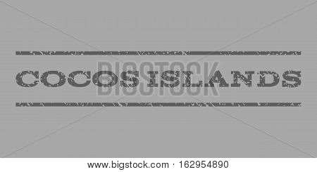 Cocos Islands watermark stamp. Text tag between horizontal parallel lines with grunge design style. Rubber seal stamp with dirty texture. Vector dark gray color ink imprint on a silver background.
