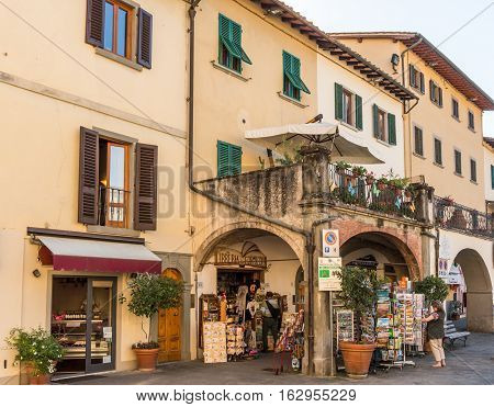 Greve in Chianti Italy - Oct 4 2016. People browsing in the Piazza Giacomo Matteotti in the city of Grave.