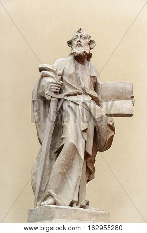 Sculpture of Holy man with a book near the Dominican Cathedral in Lviv (Lvov) Ukraine