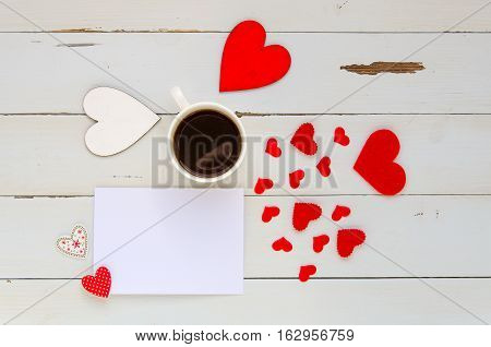 St Valentine's Day vintage overhead template with blank note for confession, hearts and coffee mug on wooden background