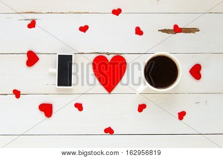St Valentine's Day vintage overhead template for I love you text confession with hearts and coffe mug on wooden background