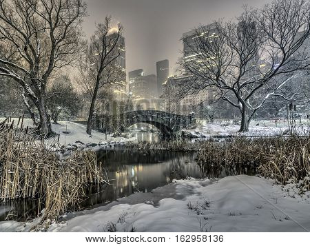 Gapstow Bridge is one of the icons of Central Park Manhattan in New York City during snow storm at night