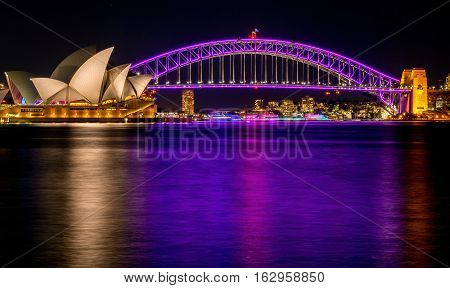 Sydney, Australia - May 29, 2016: Sydney Opera House and Harbour Bridge by night. Viewed from Mrs Macquarie's Chair. High resolution long exposure image.
