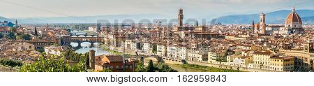 Panorama view of Florence with Duomo Giotto's bell tower Santa croce palazzo signoria and ponti vecchio from Piazzale Michelangelo.