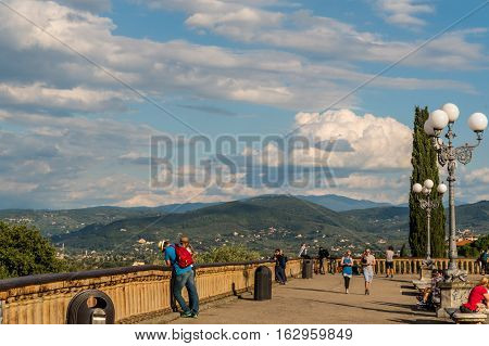 Florence ITALY - Oct 5 2016. People enjoy the day at Piazzale Michelangelo.