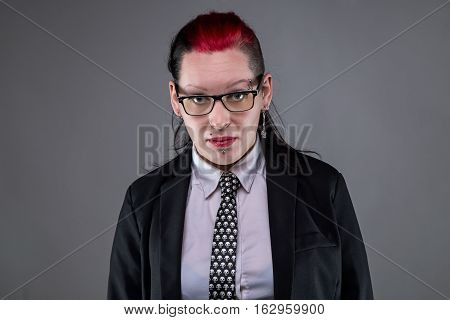 Business rock woman in glasses on gray background