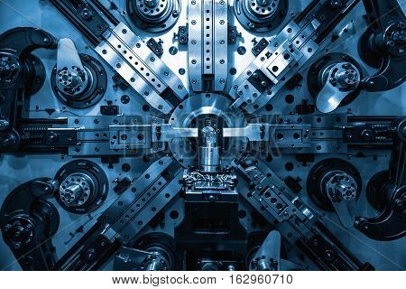 Operator machining automotive part by turning machine Industry machine background