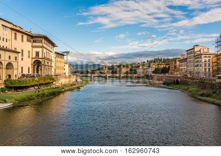View of Ponte alle Grazie on the Arno river from Ponte Vecchio