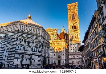FLORENCE ITALY - Oct 5 2016. Tourists on Piazza del Duomo in front of the cathedral of Florence - Dom Santa Maria del Fiore bell tower Campanile di Giotto and Baptistery