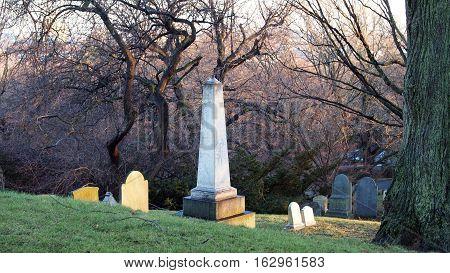 Obelisk grave shot at dusk in the winter.