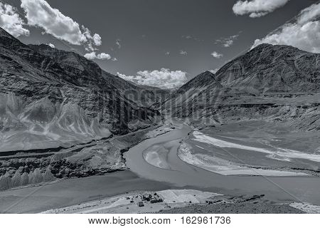 Scenic view of Confluence of Zanskar and Indus rivers - Leh Ladakh Jammu and Kashmir India. Black and white image.