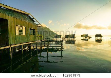 Gloomy tropical sunrise over water and islands,Timbun Mata,Semporna,Sabah,Borneo. Fishing & Sea Gypsy village sunrise,Timbun Mata,Semporna.