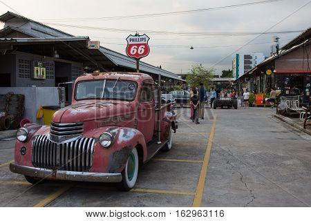 BANGKOK THAILAND - SEPTEMBER 17 2016: Old vintage car at Night market Srinakarin or train market. This market is open every Wednesday to Sunday.