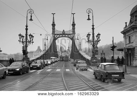 BUDAPEST HUNGARY -DECEMBER 8 2016: Liberty Bridge at cold foggy day. Black and White. Budapest Hungary