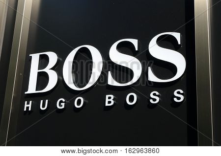 OSAKA JAPAN - OCTOBER 18, 2016: HUGO BOSS fashion brand logo. Hugo Boss often styled as BOSS, is a German luxury fashion house founded in 1924 by Hugo Boss.