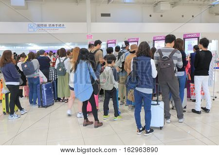 OSAKA JAPAN - OCTOBER 18, 2016, 2016: Unidentified people check in at Peach airline counter Kanasai airport. Peach airline is a LCC based in Kansai airport.
