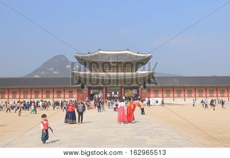 SEOUL SOUTH KOREA - OCTOBER 19, 2016: Unidentified people visit Gyeongbokgung Palace  in Seoul. Gyeongbokgung Palace was the main royal palace of the Joseon dynasty built in 1399