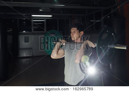 Barbell Front Squat Exercise - Athletic Man During Intense Workout At The Gym.