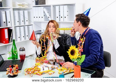 Businessman And Businesswoman Celebrating  Together In The Offic