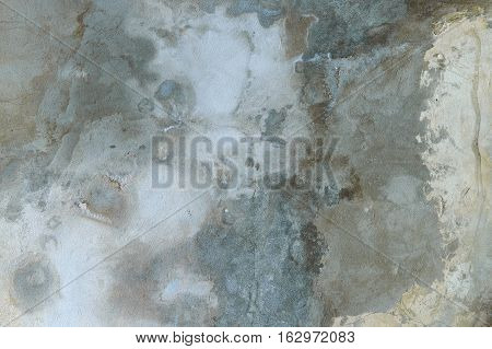 grunge old house wall. textured background. plaster gray and blue hue